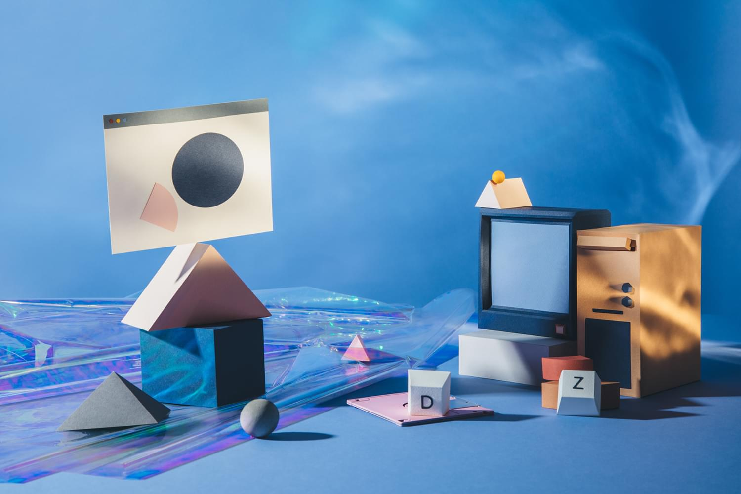 An assortment of objects representing cloud companies, such as a computer tower and television with smaller objects surrounding