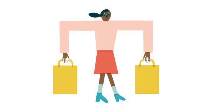 Woman carrying two shopping bags