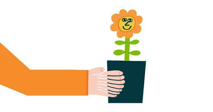Person holding a flower in a pot